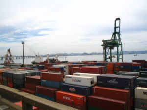 Port of Thailand with a pile of different container vans and a crane
