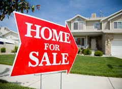 A signage of a home on sale in red fill arrow pointing a house unit