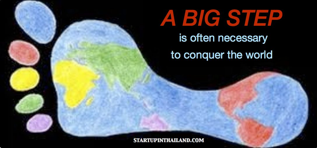 A colorful big foot drawing of world map with text caption 'A big step is often necessary to conquer the world'