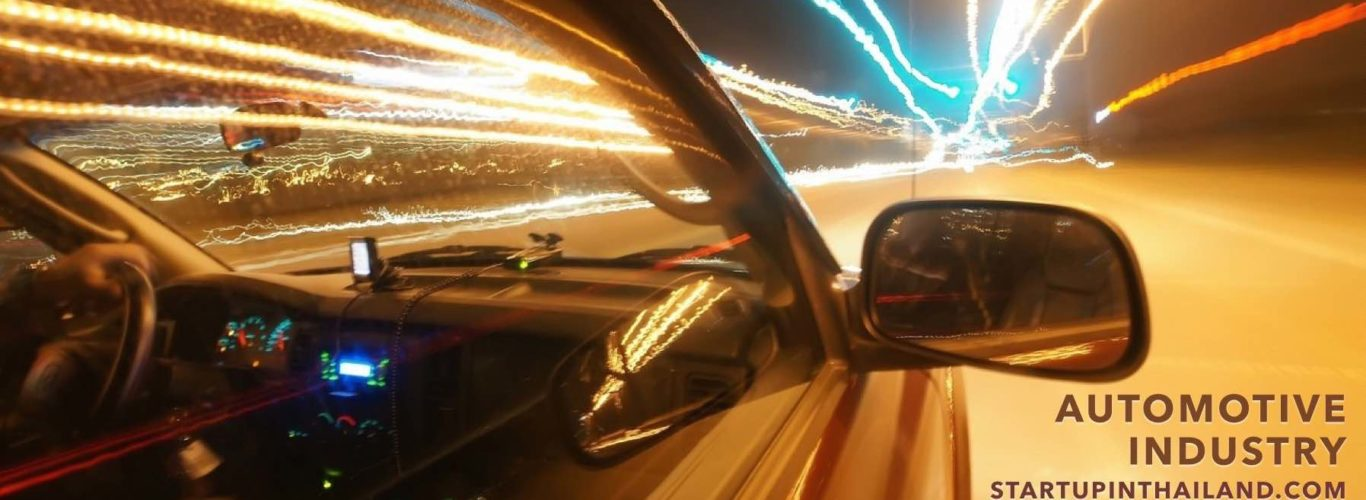 Front right side of the car view on the street with beam of night lights
