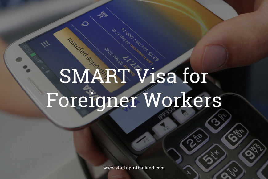 A smartphone with an app payment tap over a credit card machine with code reader in smart mobile phone with caption 'Smart Visa for Foreigner Workers'