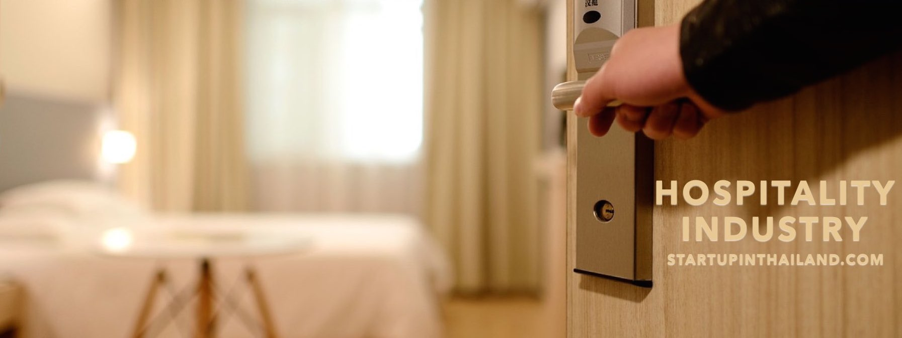 A door in a hotel opened by a service crew showing only the right hand on grip of the door handle of the room
