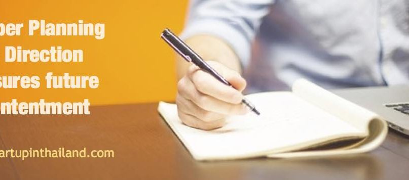 A man holding a pen and taking a notes on his right facing his laptop but not showing facial view with caption 'Proper planning and direction ensures future contentment'