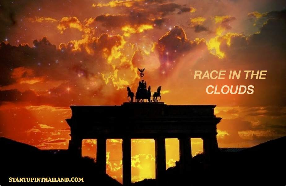 A shadow like image of an ancient greek building with horses and chariot on top in a sunset sky
