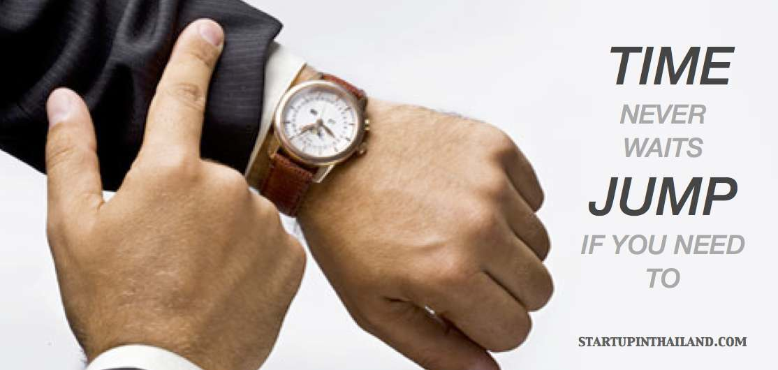 A man's hand checking on his wrist watch in a brown leather strap with text caption 'Time never waits jump if you need to'