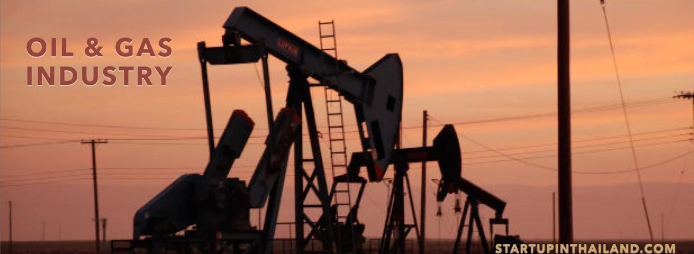 Oil and gas plant showing machine extractor in a sunset background
