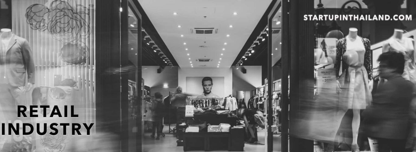 Shopping center boutique shop in a black and white filter and rush by passers