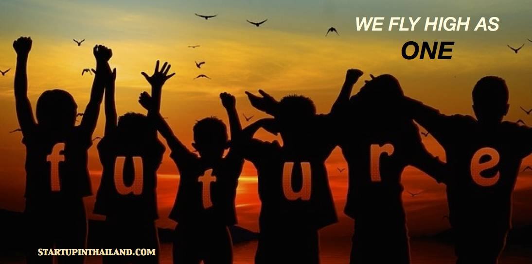 A group of youth facing back in a lake hands up in the sky with a letter forming word 'Future' in each of their body on a sunset view with birds in the sky
