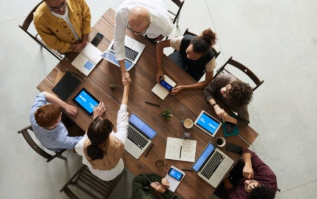 a group of people in a table during a meeting.