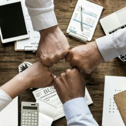 business employees having a group fist bump